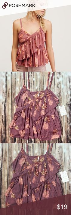 """🌸 Free People Tiered Camisole Airy printed camisole featuring a surplice V-neckline and ruffled layers. Semi-sheer style with scalloped trim and adjustable straps. Machine washable 18.5"""" long retail price $98 Free People Tops Camisoles"""