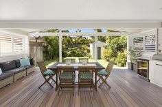 Outdoor deck + kitchen {plantation shutters, planting} | via domain.com.au, 77 Wyuna Avenue, Freshwater #outdoorkitchen