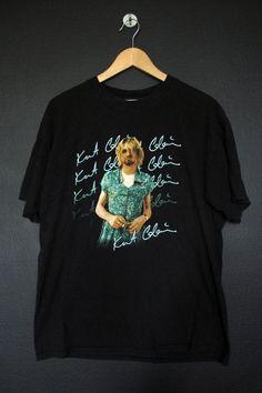 Kurt Cobain Nirvana 1990's vintage Tshirt, size large. Measurements Pit to Pit: 20.5 Back of Collar to Bottom: 27 This shirt is in great vintage condition with some fading throughout and minimal cracking on the graphic. We do our best to describe all items. All shirts are sold in As-Is cond