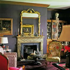 wonderful room color, floral chair and that fireplace ~ Billy Baldwin design