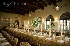 Beautiful reception decor! Those chairs, the pillars, the flowers.. all so gorgeous!