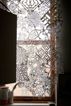 paper cut. this is beautiful. makes me wonder about doing the same but with real doilies.