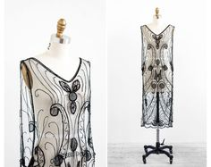 ...............r e s e r v e d.  ...............r e s e r v e d.  ...............r e s e r v e d.  ...............r e s e r v e d.  ...............r e s e r v e d.      Unutterably beautiful vintage 1920s 20s dress.    ✧ custom made -- one of a kind!  ✧ sheer black mesh  ✧ sparkling black beads + sequins in an elaborate art deco design  ✧ open sides with black + orange marbled silk panels  ✧ deep v neckline + backline  ✧ slips on over the head    This dress is pure magic; from the art deco…