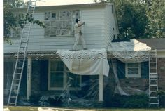 Painting aluminum siding with an airless sprayer