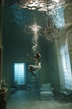 Mesmerised by this floaty, underwater photograph by Phoebe Rudomino. Shot at Pinewood Studios where they have several huge underwater tanks.