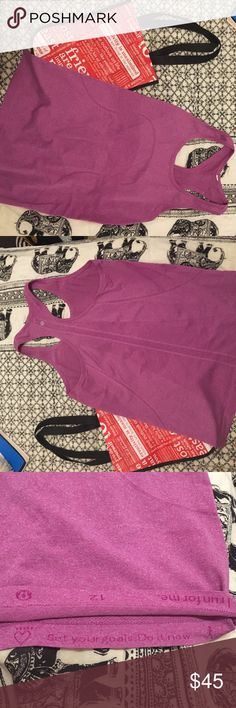 Lululemon swiftly tech racerback Really pretty raspberry color, they don't make this color anymore. In perfect condition, Shows  no sign of wear. I absolutely love this top it's Just way too big for me these days. Also selling on M Tops