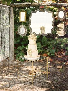 love hanging vintage mirrors as wedding decor
