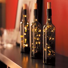 i always have empty wine bottles! now I have a use for them!! Wine Bottle Lights  Recycle empty wine bottles into these chic decorative wine bottle lamps for your next cocktail party. Decorating a basement bar or rec room can cost a fortune. But use this fun idea for turning wine bottles into inexpensive art!