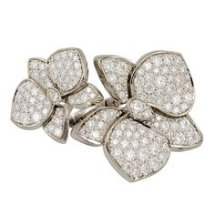 Cartier Diamond Flower Ring | From a unique collection of vintage fashion rings at http://www.1stdibs.com/jewelry/rings/fashion-rings/