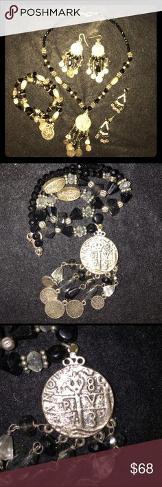 "🖤Handmade Indian Jewelry Set🖤 The entire set is just amazing!  The necklace is made with glass beading, Light bronze accents & 1"" coin, 3 1/2"" coins & 2 1/4"" coins. The first pair of earring have a 3"" lightweight drop patterned like the Necklace The 2nd pair of earring is made with black silver, beading & Rhinestones with another Rhinestone at the stud with a 1 1/2"" lightweight drop The double latched bracelet is patterned just like the necklace coins are 2/3"", 1/3"" & 7mm. Ask any…"