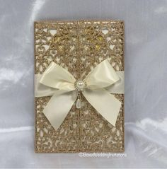 What do you think about this gold glitter lasercut invitation? The big bow and and embellishment are the perfect finish to make this invite one of a kind. See more at www.boxedweddinginvitations.com #invitation