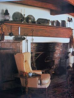 what if you could make one ugly large no-mantle fireplaces into a primitive fireplace? Add mantle, paint color, cupboards, beams, etc.