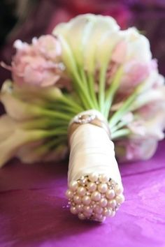Finish off the end of your bouquet with corsage pins, no wet and leaky flowers. And would make for pretty pics :)