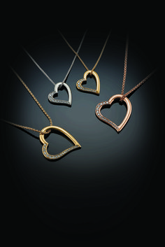 Love me do! Gorgeous heart pendants available in two sizes set with a sprinkling of sparkling diamonds.