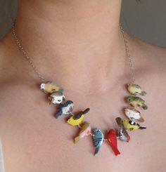 I want this just because I know Catherine would love playing with it when I'm wearing it - Birds of a Feather Necklace. $65.00, via Etsy.