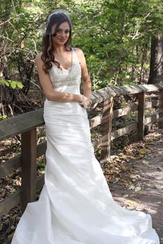 Trumpet/mermaid style wedding gown with lace bodice, ruching and silk shantung skirt, Sleeveless jeweled straps, button and zipper back closure