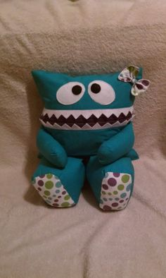 Teal Pajama Eater Pillow Pal Monster with Teal Mouth and Purple, Teal, and Lime Polka Dot Feet and Bow. $27.50, via Etsy.