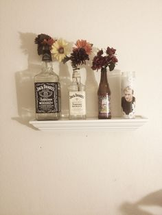 cigarettestainedliez:    Jack Daniel vases and Heath Ledger with some daisies