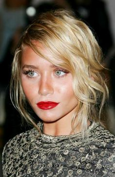 bronzed skin and a sweeping side fringe compliment bold lips in the summer.  so do ashley olsen's saucer eyes.