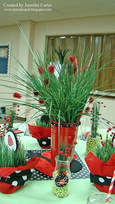 Ladybug party centerpieces i like the red with the black polka dot ribbon