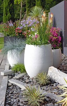 Contemporary fiber cement planters in brilliant white with colorful flowers and . - Contemporary fiber cement planters in brilliant white with colorful flowers and grasses. Great idea for front yard curb appeal or a backyard seating area Small Front Yard Landscaping, Backyard Landscaping, Landscaping Ideas, Backyard Ideas, Diy Garden, Garden Pots, Garden Ideas, Cement Planters, Planters Flowers