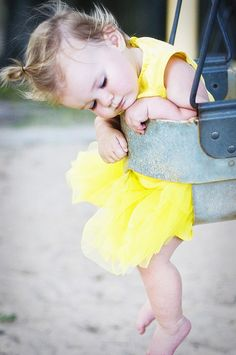 This is a great idea for a framable photo of your little one. All dressed up and relaxing in a swing!