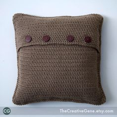 button closure crochet pillow...not sure if i like the colour ... but like the idea
