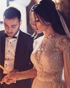 A Lebanese couple during their wedding rituals! Veil Hairstyles, Wedding Hairstyles, Dream Wedding Dresses, Bridal Dresses, Wedding Goals, Beautiful Bride, Wedding Styles, Designer Dresses, Marie