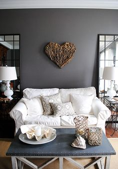 country living room with gray walls, a white sofa and a sisal rug