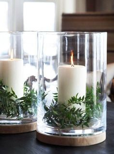 Ferns and pillar candles in glass hurricanes, maybe add some lovely white flowers #pillarcandles Christmas Centerpieces, Christmas Decorations, Table Decorations, All Things Christmas, Christmas Crafts, Christmas Ideas, Tropical Wedding Reception, Romantic Candles, Winter