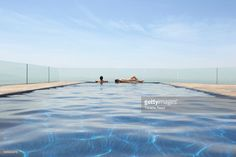 Couple in infinity pool overlooking scenic view