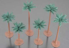 Woodland Scenics Scene-A-Rama Palm Trees. Each tree has a removable base allowing you to temporarily or permanently place the tree. Trees can be modified by adding or removing foliage.