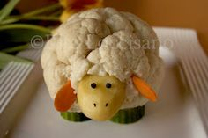 Vegetable Lamb - cute table decoration on a veggie tray..I think it's a potato with cauliflower stuck to it; maybe with toothpicks, and cucumber legs or zucchini??