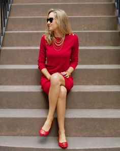 gold necklace with red dress and ballet flats