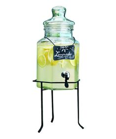 Quench the family's thirst in sophisticated style. Filled with iced tea or lemonade, this glass dispenser is just the thing for keeping cool on hot summer days. It's perfect for parties and comes with a chalkboard placard and metal rack too!