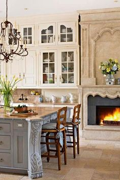 Country Kitchen with Ceiling height cabinets, French country, Troy lighting: bordeaux crystal chandelier, Paint, Cabinets