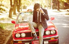 An E30 and a well-dressed man.. Yes.
