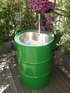 If you love spending time outdoors in the garden, here's a great way to turn an oil drum into an outdoor sink. Connect the sink to a hosepipe for water on tap when you need it.