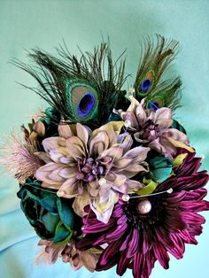 Purple Silk Bridal Bouquet minus the feathers. Silk flowers could work.