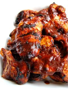 Sweet Chili BBQ Chicken!! I'd say this chicken falls in the category of lip smackin' hot damn good! The sauce starts with a tomato base and grows from there, getting its sweetness from brown sugar and honey, and a little kick from chili powder and cayenne...Yeehaw!