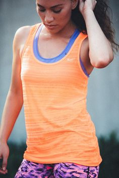 All over orange. Stay cool and run confident in bright, bold colors. The Nike Dri-FIT Touch Breeze Tank.