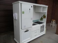 make an old entertainment center into a kid's kitchen! cute!