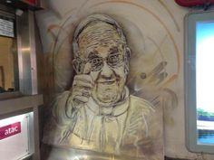 "#PopeFrancis | PHOTO -- ""A mural outside the ticket office at the Metro station at piazza di Spagna in Rome."""