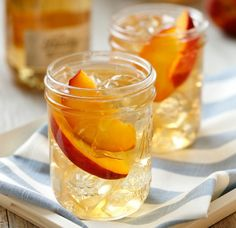 Refreshing flavored cocktail recipes that can be made in big batches, refrigerated, and served as soon as guests arrive.