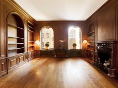 a wood paneled library with arch arched windows in a multi million dollar new york city black white home office cococozy 5