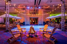 The lodge area had an elevated DJ platform, seating around a campfire, umbrella tables, and a dance floor.