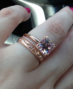 Wow! Love the ring, the diamond wedding band (so skinny!) and then the gorgeous scroll engraved ring - and rose gold to boot! <3