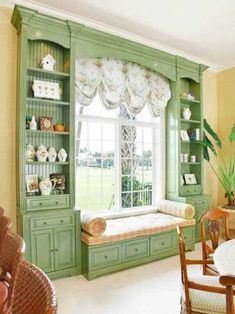 Looks like a lovely spot to read in. Love the shelves around the window seat.