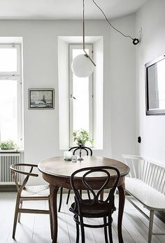 Small round kitchen table with one bench seat and two chairs!