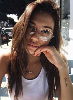 Alexis Ren natural day clear frame glasses. Stay in style with these gold thin frame large clear aviator style non-prescription glasses